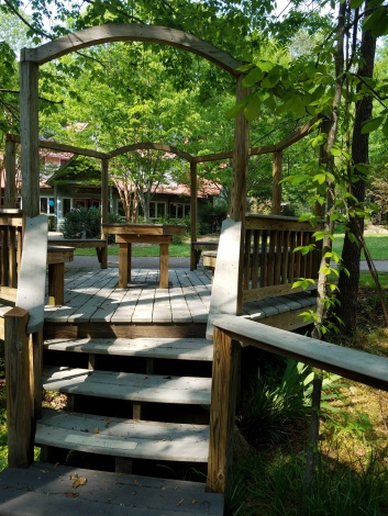 Seating Area by the playground - deck made of wood, surface planks are composite