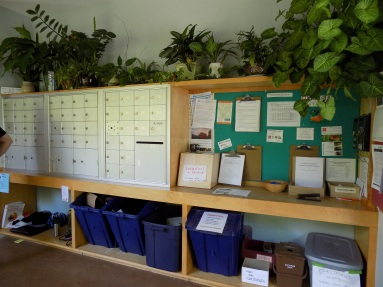 Mail room (with convenient recycling), bulletin boards, suggestion box, and live plants